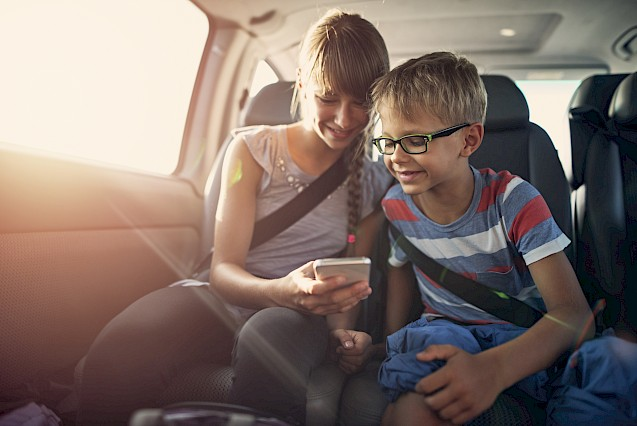 Kids playing on phone in car