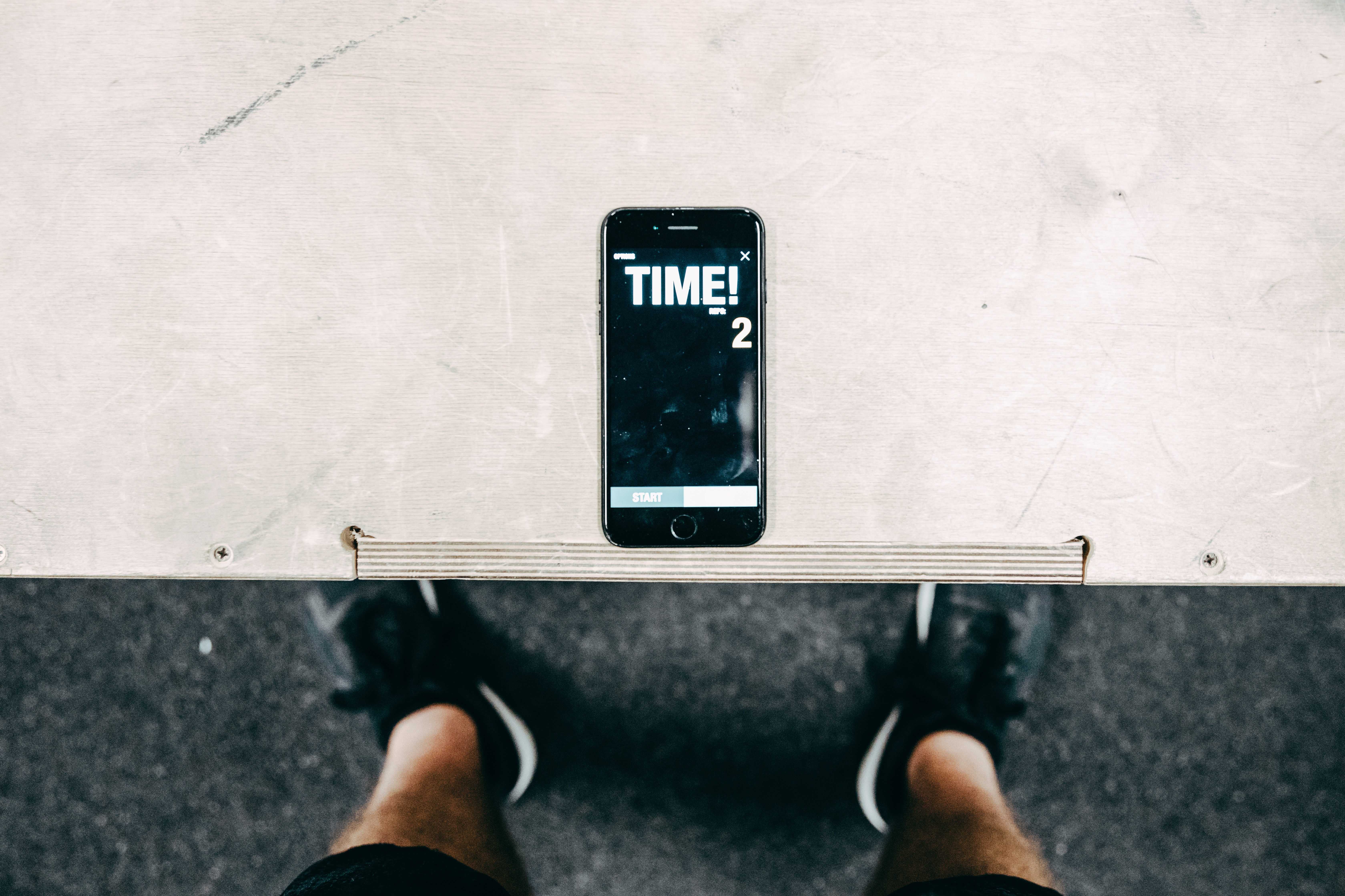 Phone on table timing a workout