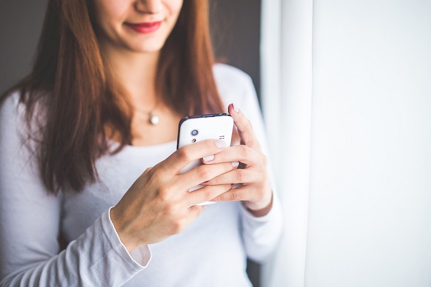 woman holding phone