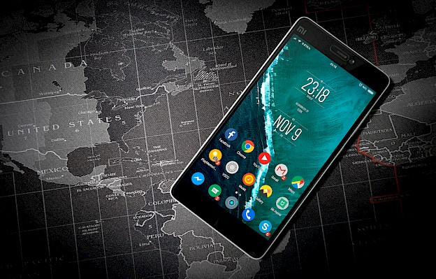 Smartphone in front of a world map