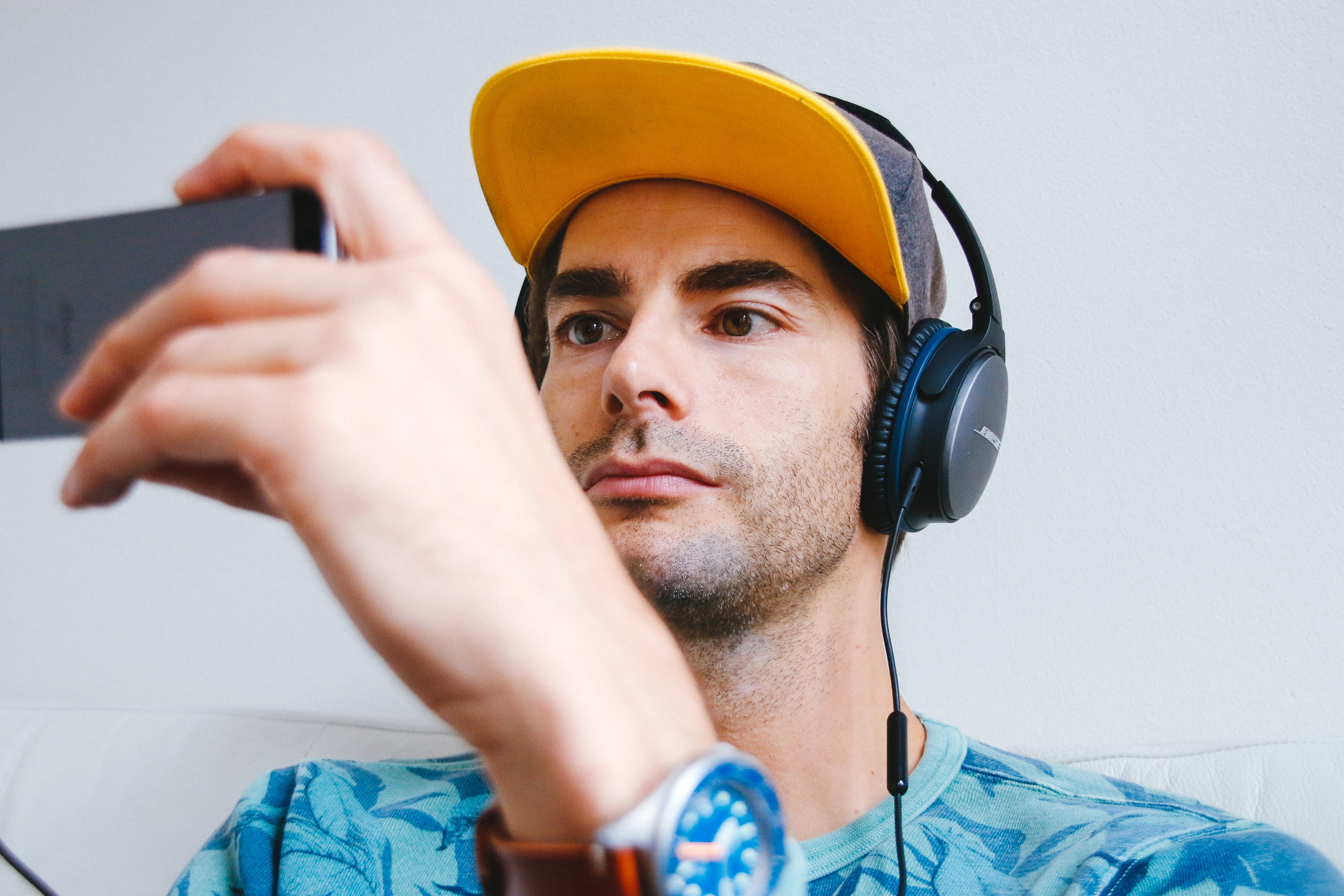 Man streaming video on a smartphone